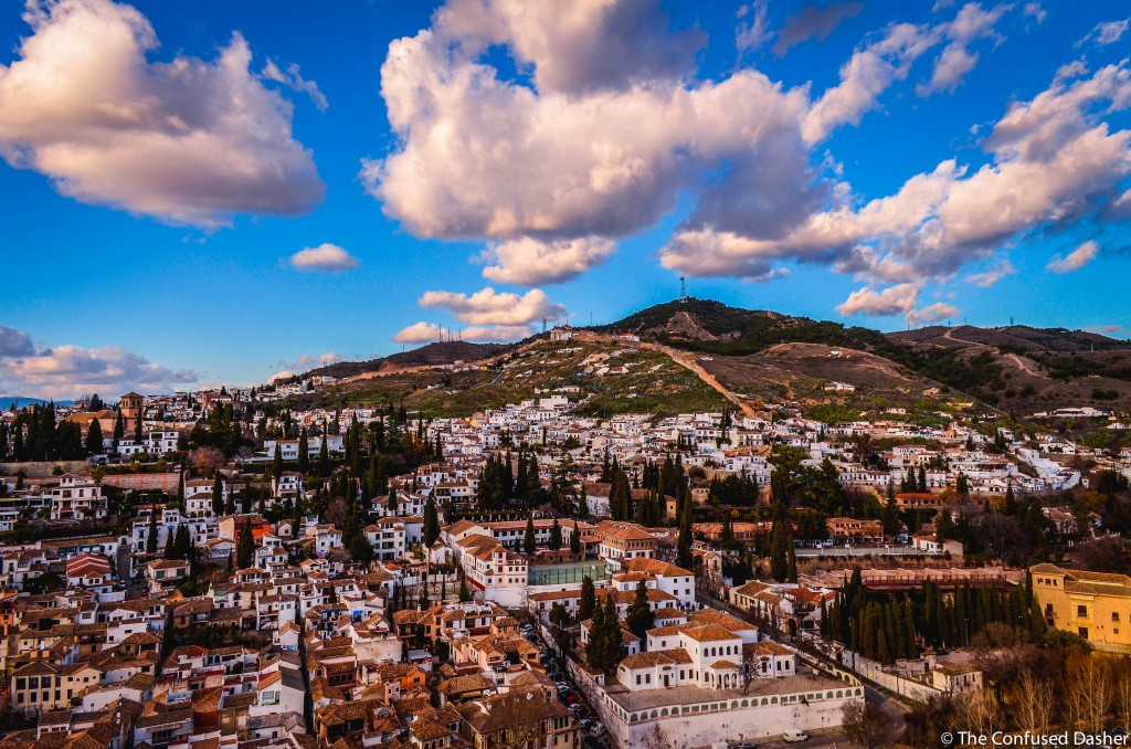 Islamic architecture inside the Generalife, confused dasher, explore granada in 48 hours, tips to visit the alhambra, the Palacio de Generalife, the sultan's leisure palaces, pebble walkaway in the garden, white washed houses of granada andalusia spain