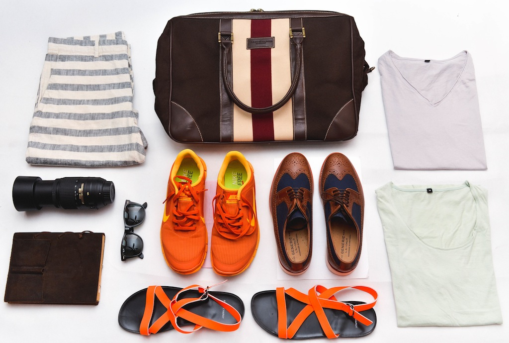 the art of packing, confused dasher goes to taiwan, traveling light, pierre hardy orange men sandals, muji pastel tshirts men, tommy hilfiger duffle bag, nike orange sneakers